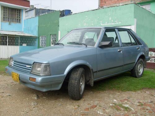Carro mazda 323 azul excelente estado