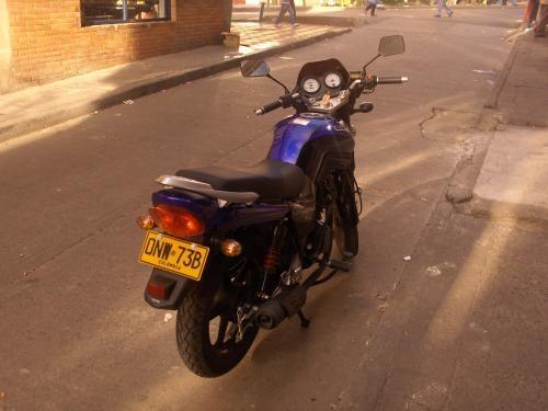 Vendo moto um fastwind color azul modelo 2009/sport