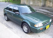 VENDO MAZDA 323 HS 2001