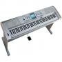 Teclado Yahama DGX 505 con pedal