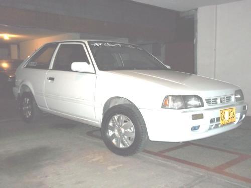 Ojo, aproveche espectacular automovil mazda 323 cupé, modelo 2001 en excelente estado tanto mecánicamente como lo demás, caja de quinta (cinco cambios adelante y uno reversa), color blanco, le funcio