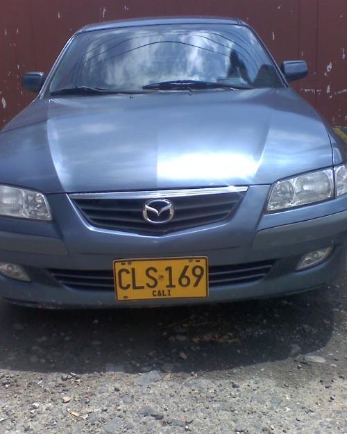 Vendo vehículo mazda 626 nmo modelo 2003 unico dueño 139.000 km. placas de cali barato $17'000.000. azul nautico