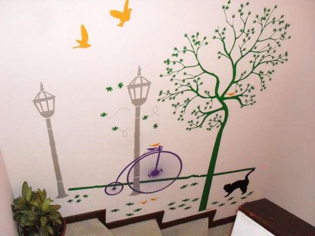 Decoracion en paredes con vinilo decorativo monarca en bogotá.