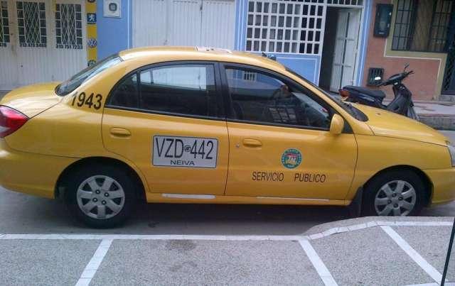 Fotos de Vendo taxi kia rio en neiva huila a gas y gasolina unico dueño 2