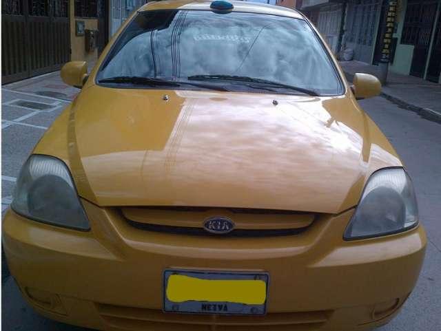 Vendo taxi kia rio en neiva huila a gas y gasolina unico dueño