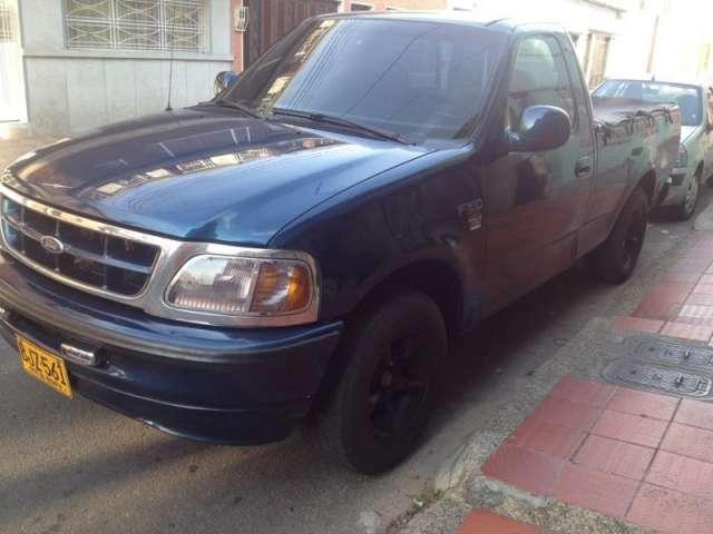 Fotos de Se vende camioneta azul ford con platon excelente estado no tiene pico y placa 3